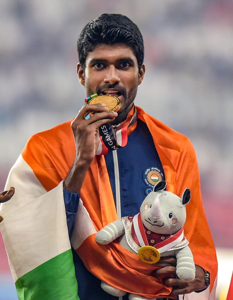 India's Jinson Johnson celebrates his gold medal winning effort in the men's 1500 metres. PTI