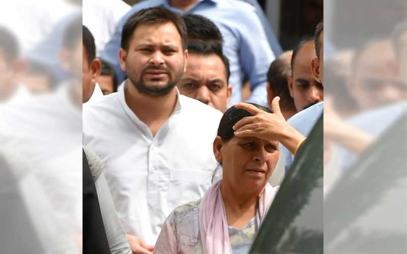 Former Bihar chief minister Rabri Devi with her son Tejashwi Prasad Yadav comes out of Patiala House court after appearing before a special court in the (IRCTC) tender scam case, in New Delhi on Friday, Aug 31, 2018. PTI photo
