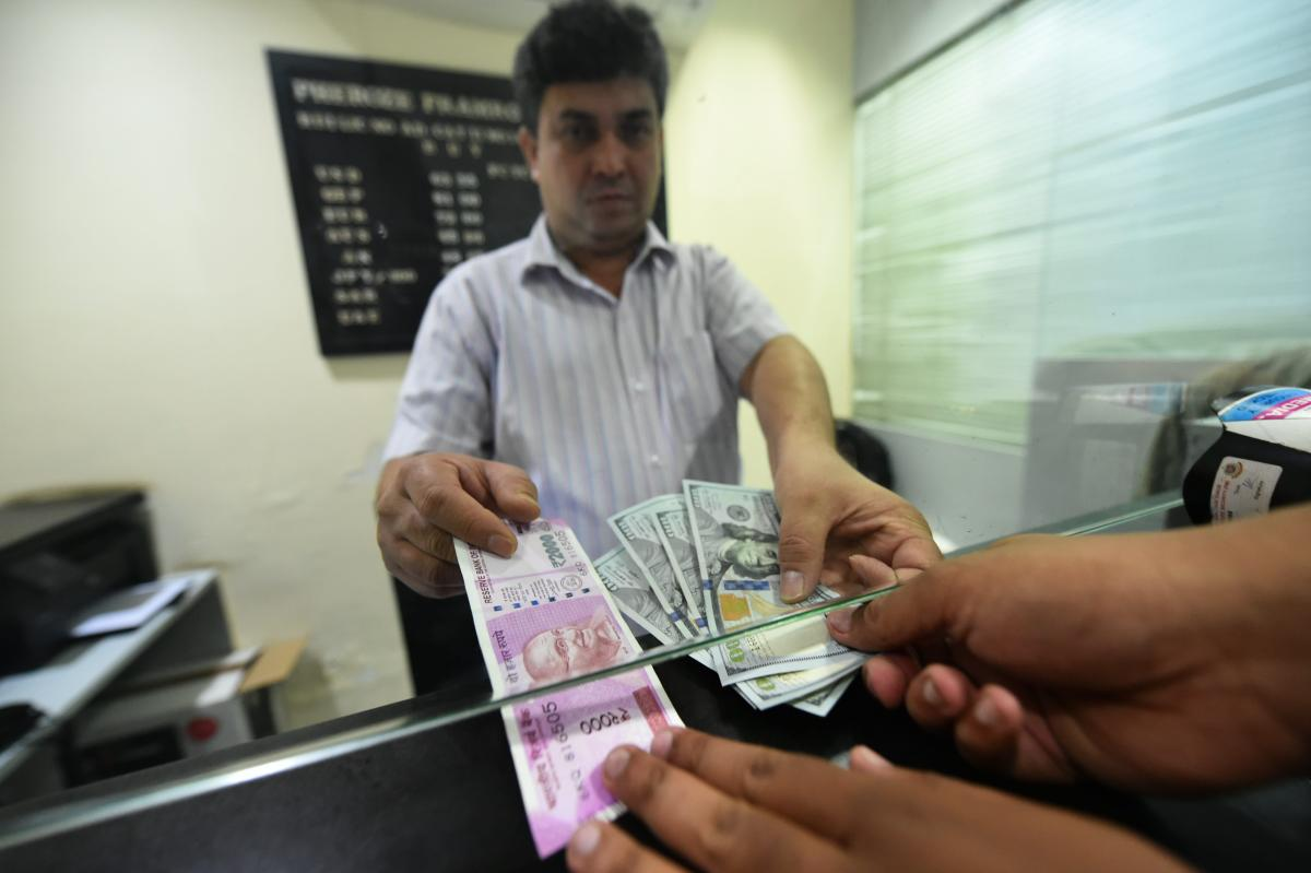 A customer exchanges currency at a forex bureau after the Rupee hit a new all-time low against US dollar in New Delhi, on Thursday, Aug. 30, 2018. (PTI Photo)