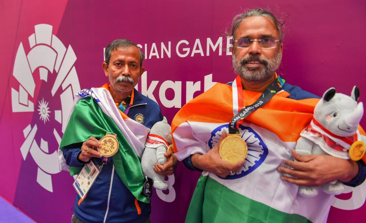 India's Pranab Bardhan and Shibhnath Sarkar with their gold medals after winning the bridge competition at the Asian Games in Jakarta on Saturday. PTI