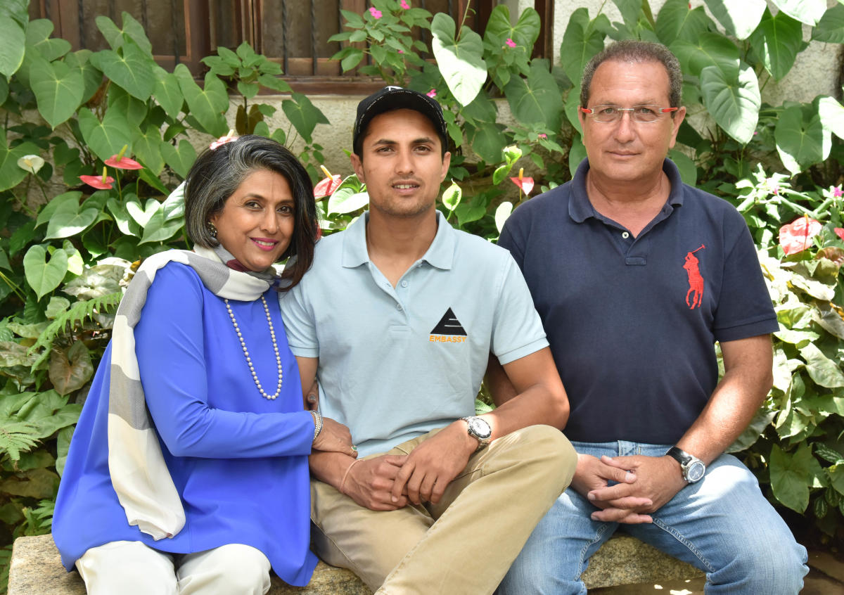 PROUD FAMILY: Asian Games double silver medallist Fouaad Mirza is flanked by his parents Indira Basapa and Dr Hasneyn Mirza at their Vasanthnagar bunglow in Bengaluru. DH PHOTO/ JANARDHAN B K