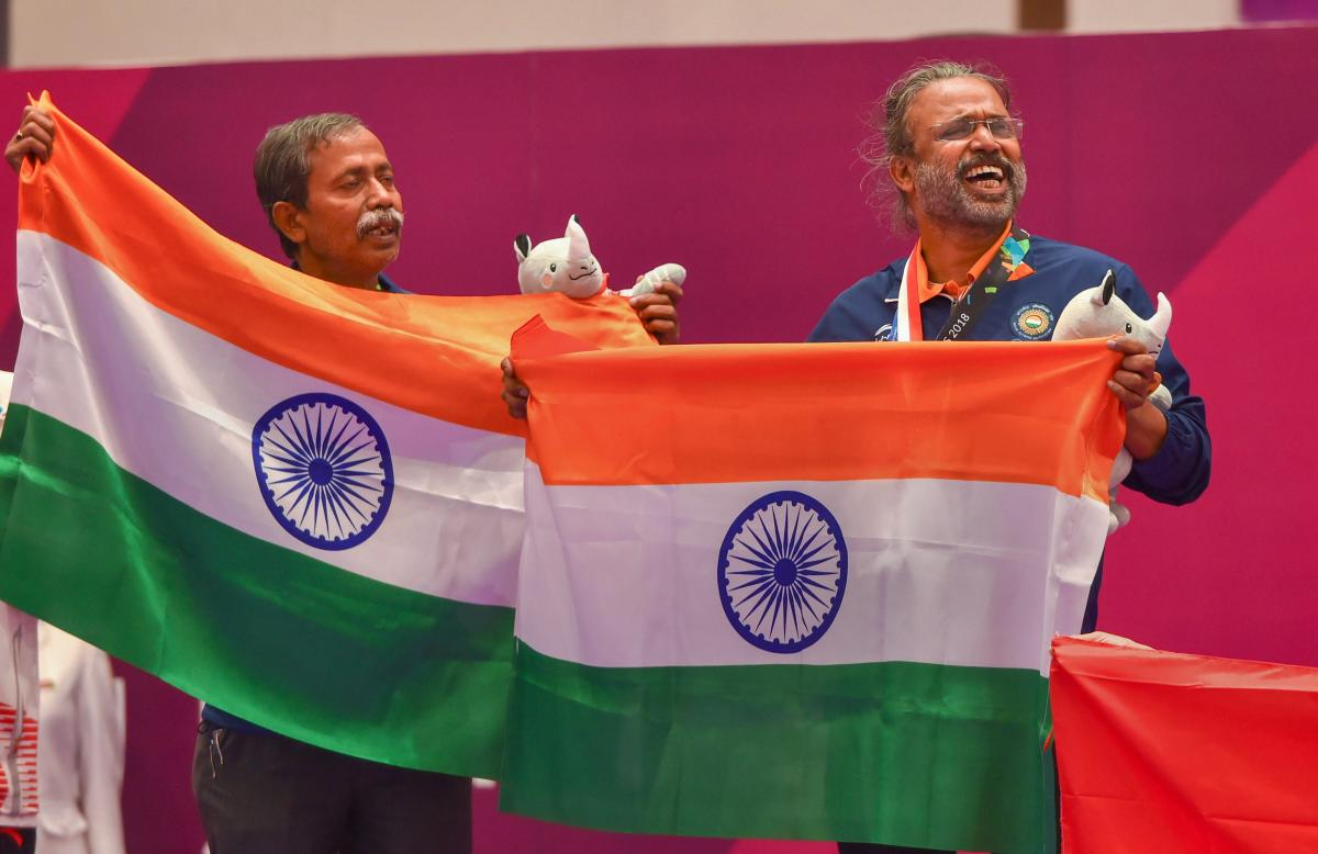 Jakarta: Gold medallist India's Pranab Bardhan and Shibhnath Sarkar pose with the Indian tricolour after winning in bridge competition at the 18th Asian Games in Jakarta on Saturday, Sept 1, 2018. (PTI Photo/Shahbaz Khan) (PTI9_1_2018_000058B)