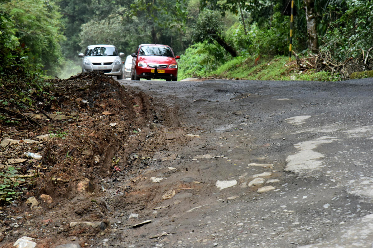 Heavy traffic and rain not only cause potholes on Charmadi Ghat, but also leave little time for repairs. DH Photo/Janardhan B.K.