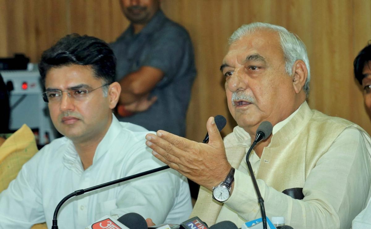 Senior Congress leader and former Haryana Chief Minister Bhupendra Singh Hooda along with RPCC President Sachin Pilot addresses the media in Jaipur on Tuesday, Sept 4, 2018. (PTI Photo)
