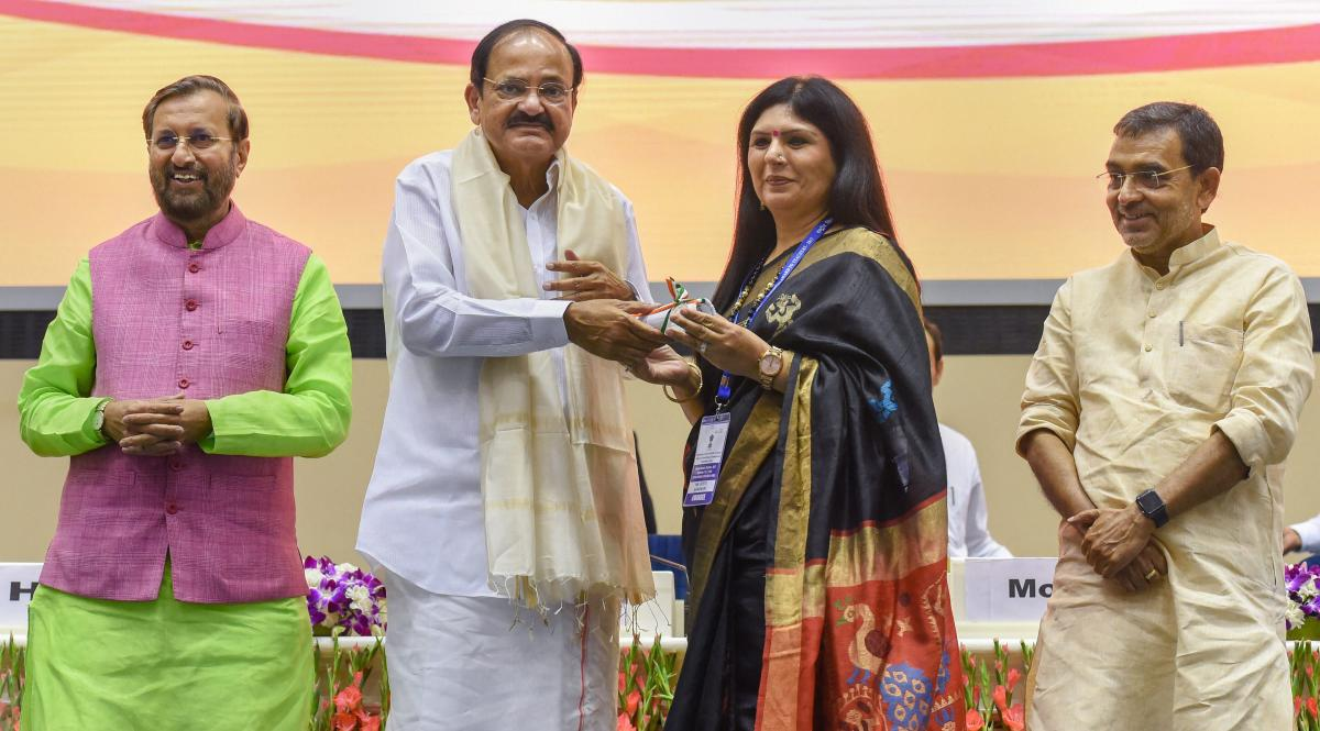 Vice President M Venkaiah Naidu felicitates a teacher at the Shikshak Diwas 2018 (Teacher's Day) function in New Delhi, Wednesday. HRD Minister Prakash Javadekar and Minister of State Upendra Kushwaha are also seen. PTI