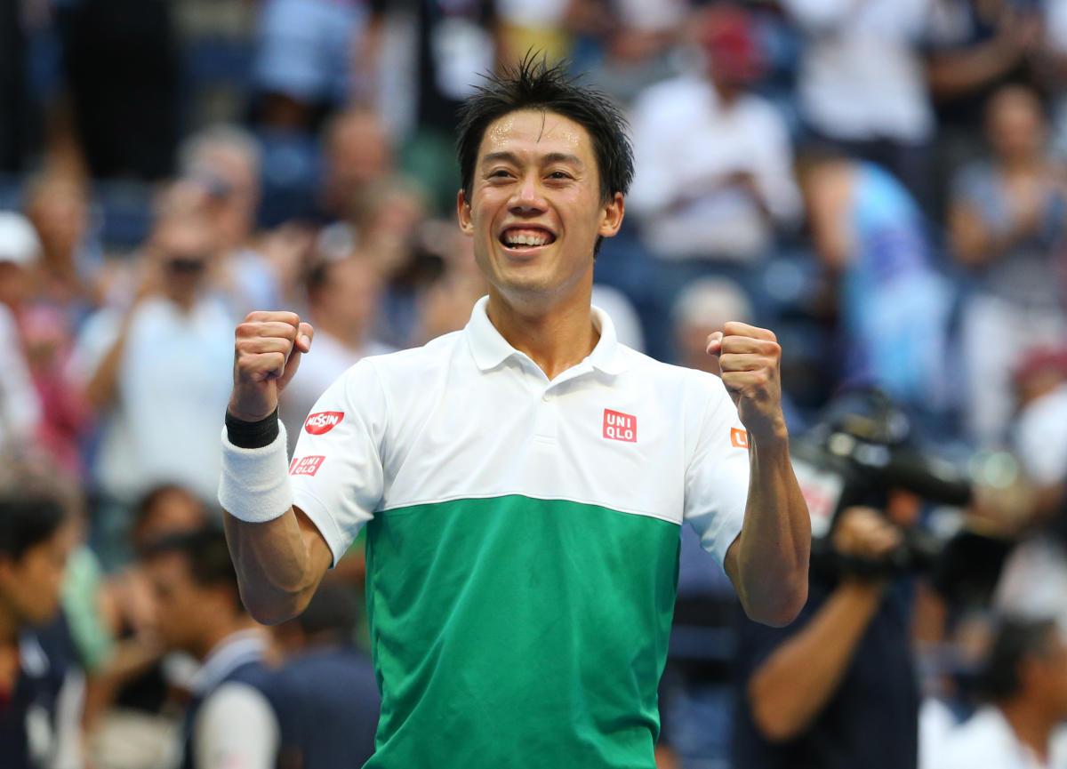 I DID IT: Kei Nishikori of Japan celebrates after winning a gruelling five-set men's quarterfinal tie against Marin Cilic of Croatia.