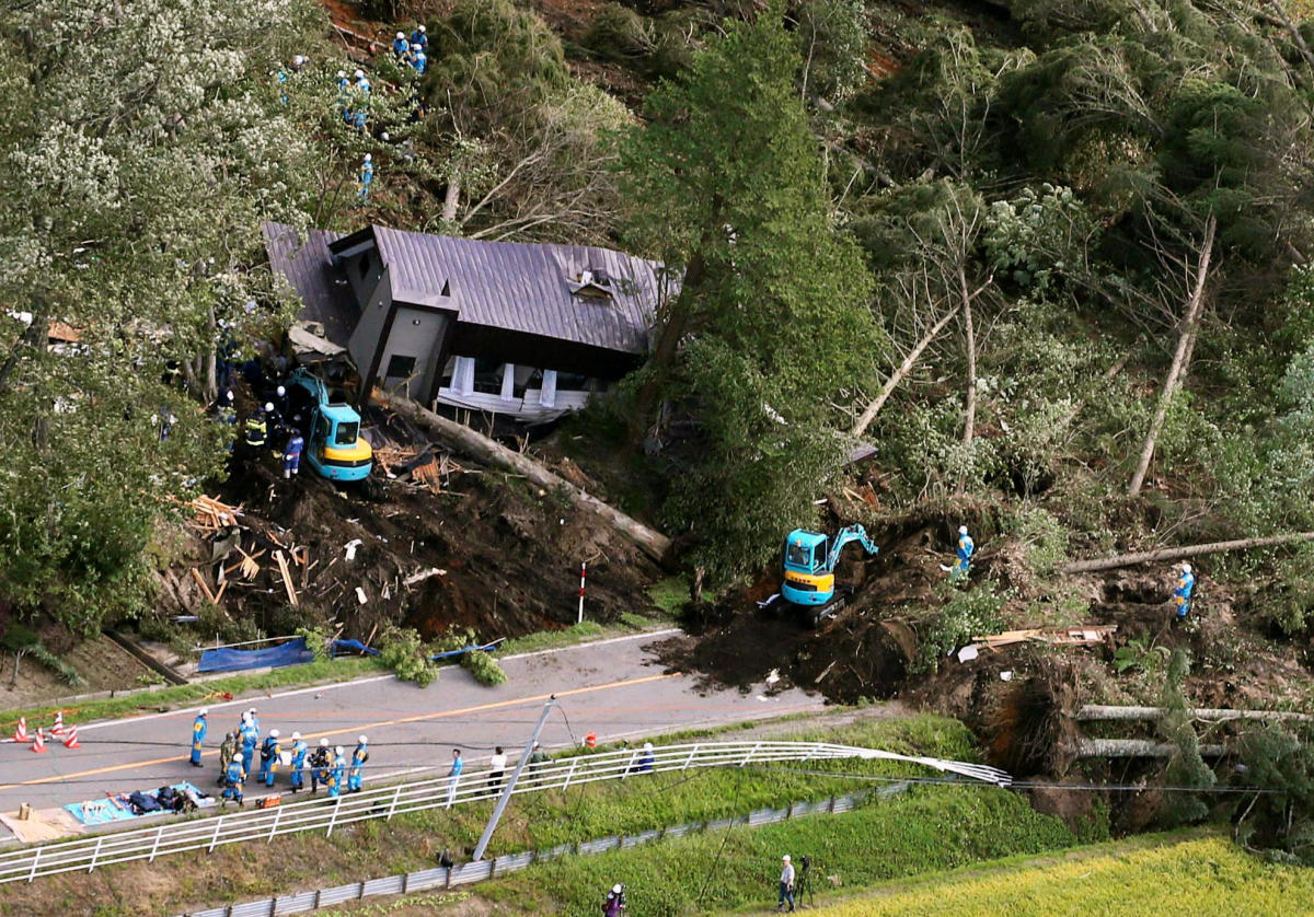 Police officers and rescue workers search for survivors from a building damaged by a landslide caused by a powerful earthquake in Atsuma town in Japan's northern island of Hokkaido, Japan, in this photo taken by Kyodo September 6, 2018. (Kyodo/via REUTERS)