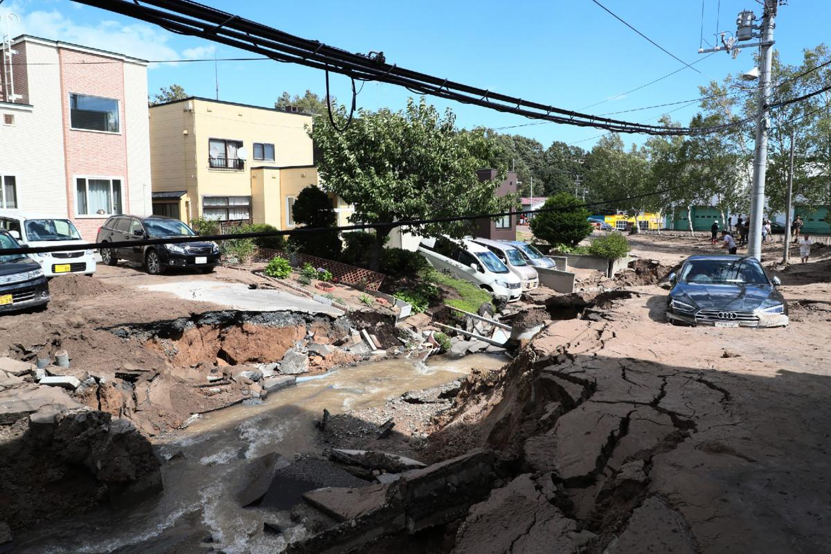 A car is stuck on a road damaged by an earthquake in Sapporo, Hokkaido prefecture on September 6, 2018. AFP