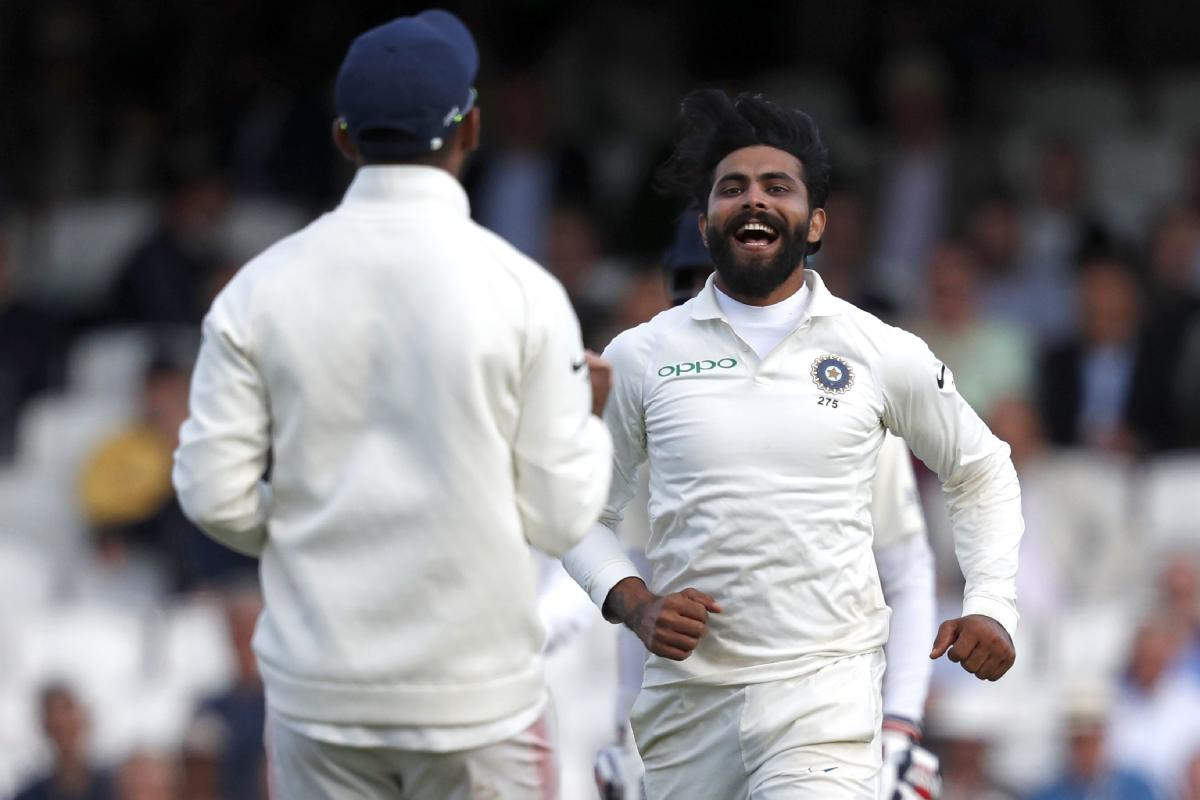 India's Ravindra Jadeja (R) celebrates after taking the wicket of England's Ben Stokes during play on the first day of the fifth Test cricket match between England and India at The Oval in London. AFP photo