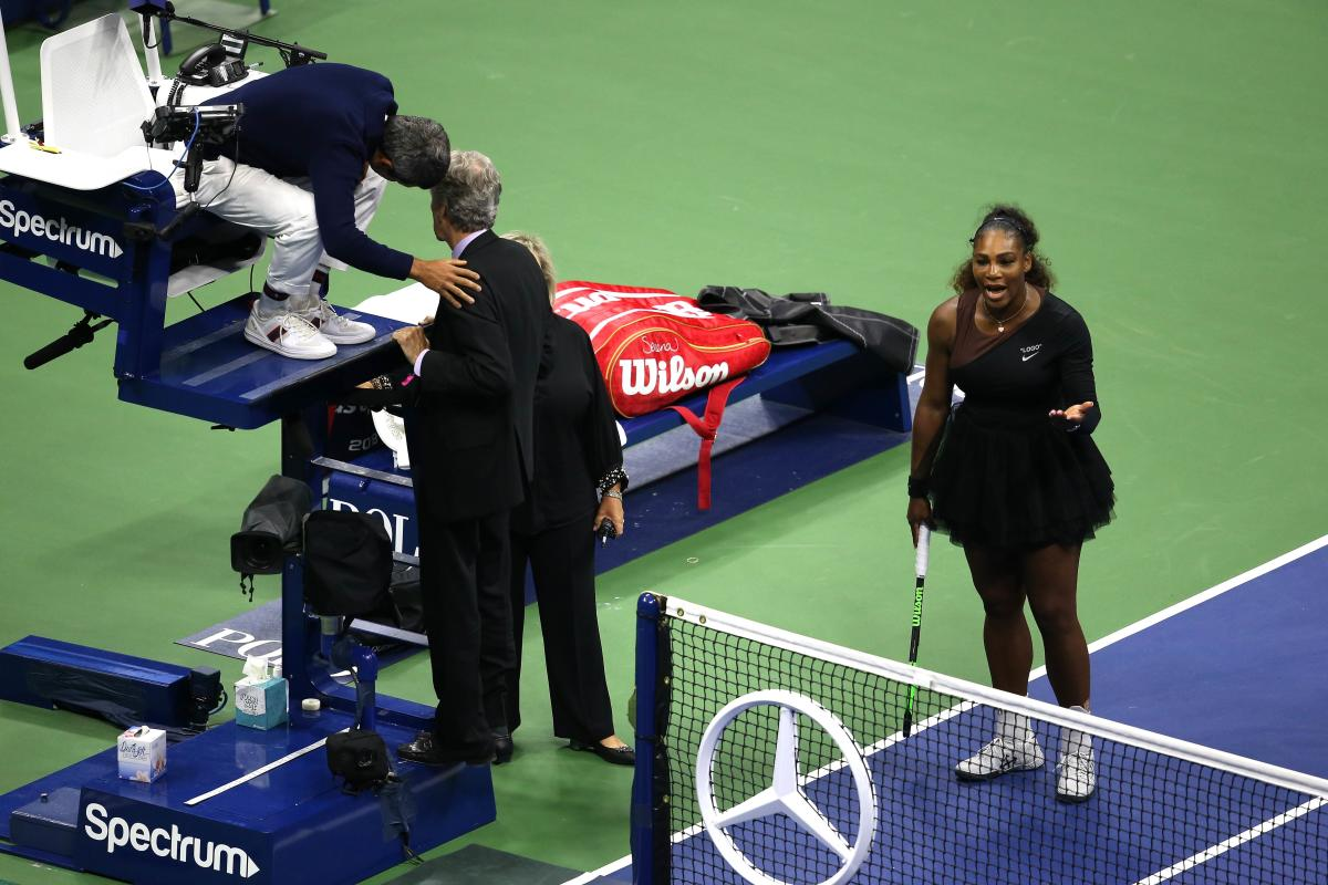 UNSAVOURY: Serena Williams fumes as chair umpire Carlos Ramos has conversation with US Open offcials during women's final on Saturday. AFP