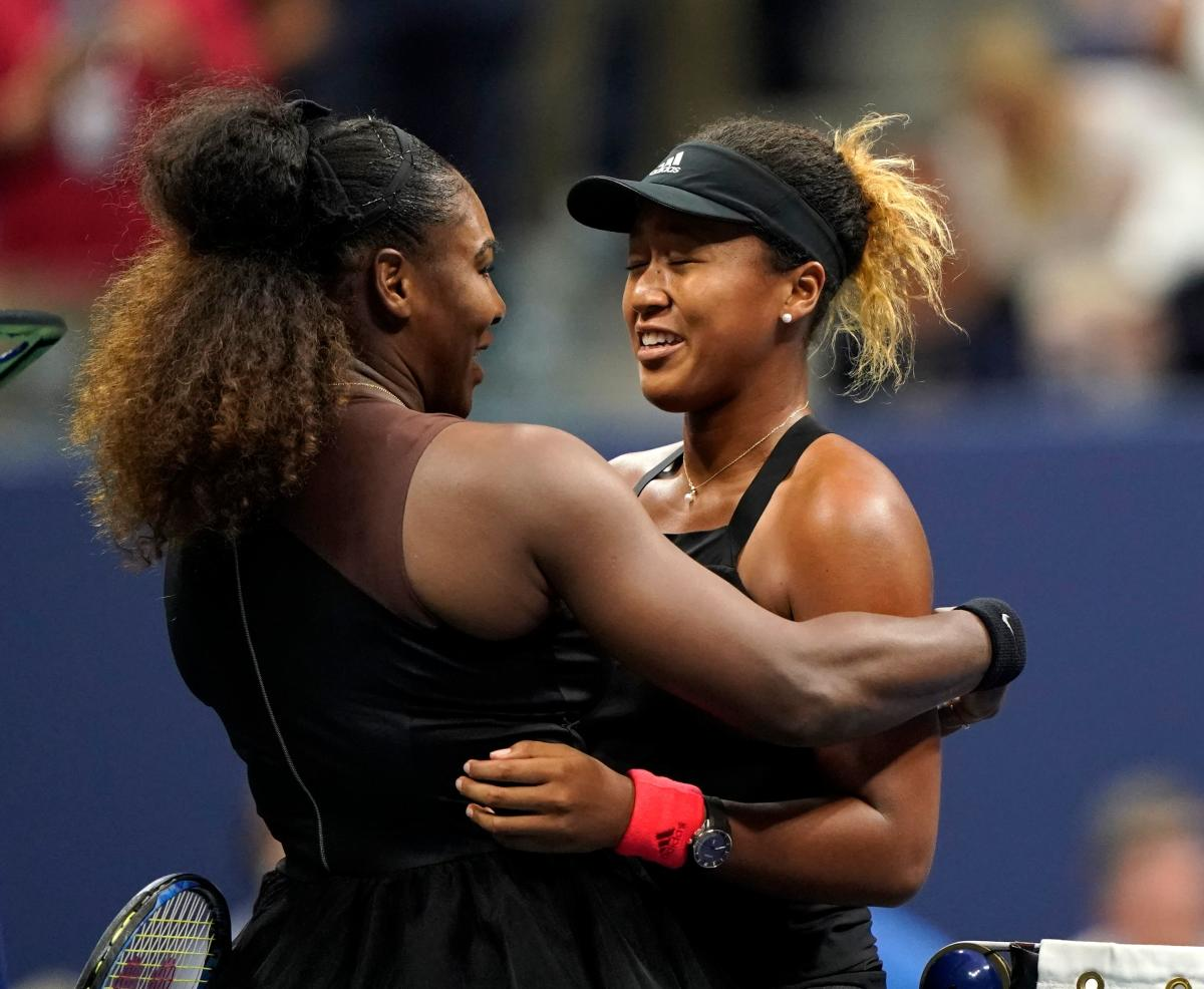 YOU DESERVED: IT Naomi Osaka of Japan (right) is being greeted by Serena Williams at the net after their final on Saturday. AFP