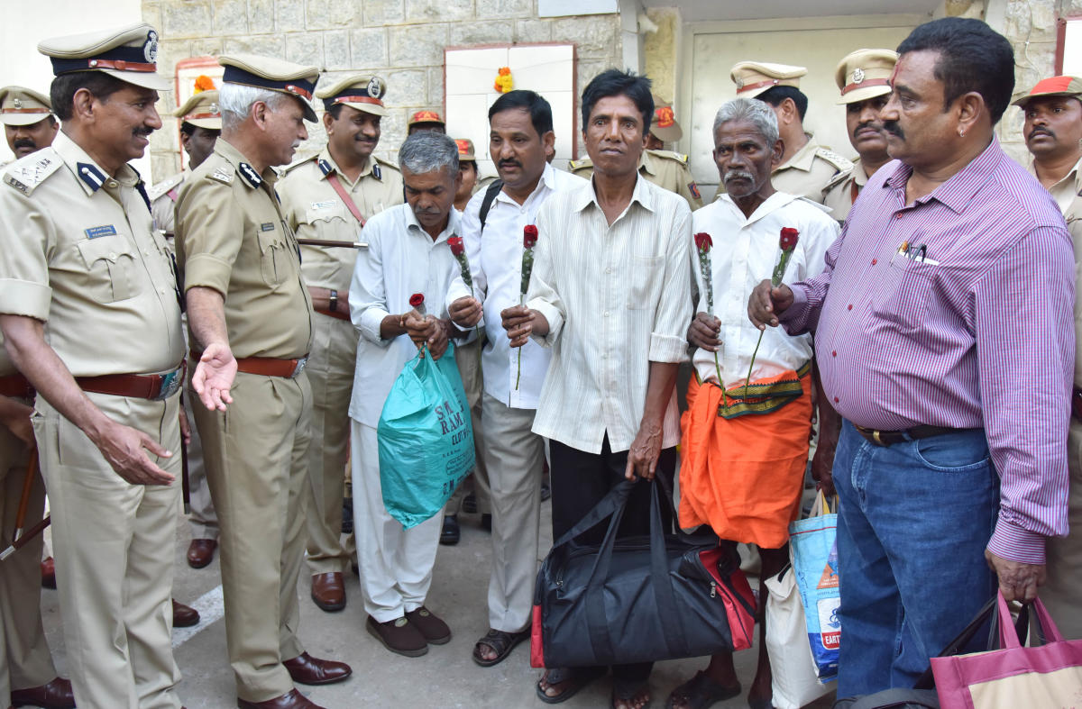 ADGP (Prisons) N S Megharikh welcomes prisoners as they walk out of the Bengaluru Central Prison on Sunday