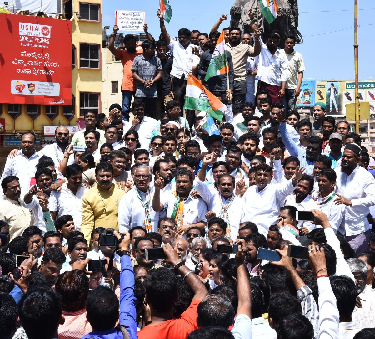 Congress party workers stage a protest at Chennamma Circle in Hubballi, during 'Bharat Bandh' on Monday.