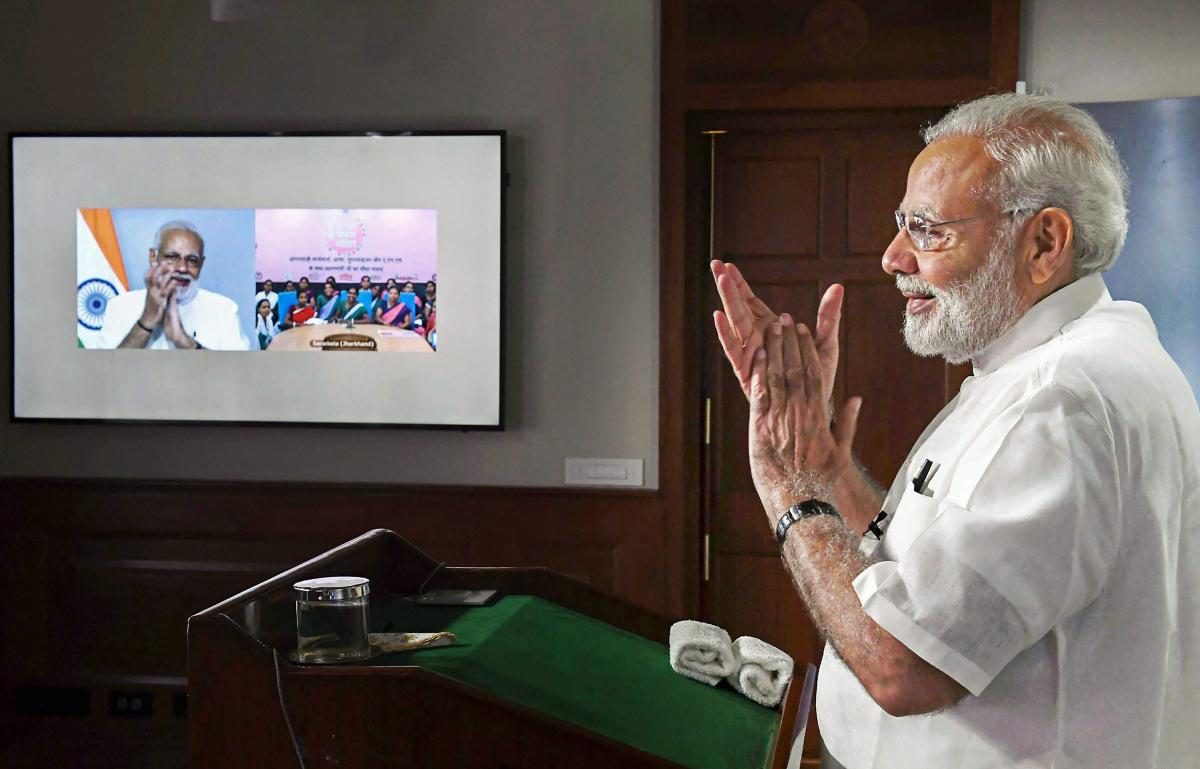 Prime Minister Narendra Modi interacts with ASHA, Anganwadi and ANM workers from all over the country through video conference, in New Delhi on Tuesday. (PIB Photo via PTI)