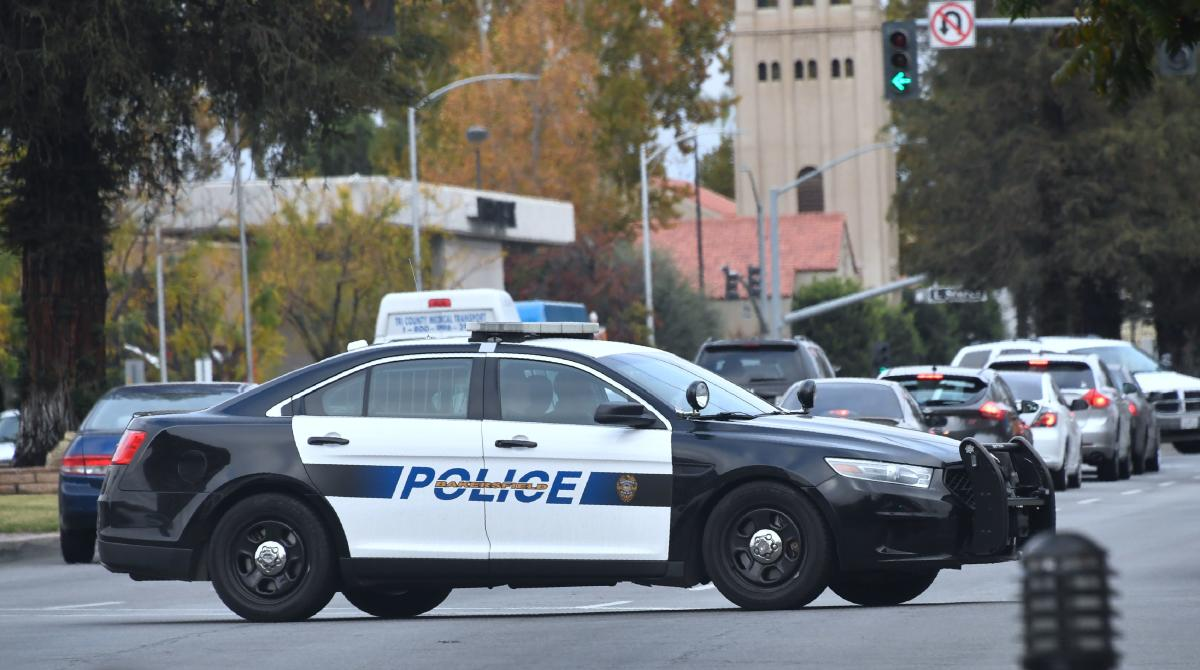 (FILES) In this file photo taken on November 17, 2017 A Bakersfield police vehicle makes patrols in Bakersfield, Kern County, California. - September 12, 2018. (Photo by FREDERIC J. BROWN / AFP)