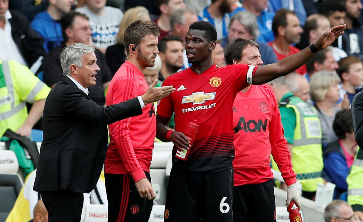 Manchester United manager Jose Mourinho speaks with Paul Pogba during the EPL game against Brighton. (Reuters File Pic)