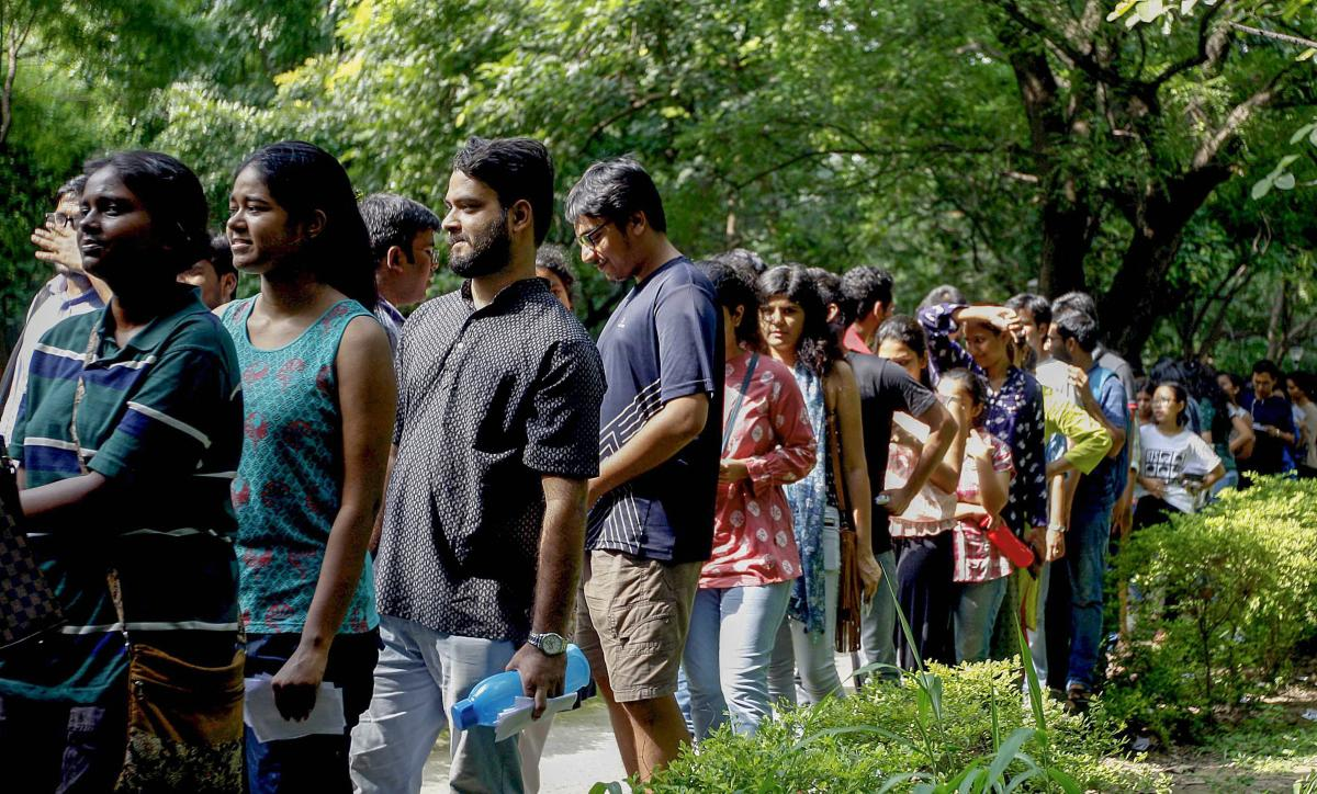 Jawaharlal Nehru University (JNU) students wait to place their votes during the students' union polls, in New Delhi, Friday, Sept 14, 2018. (PTI Photo/Ravi Choudhary)