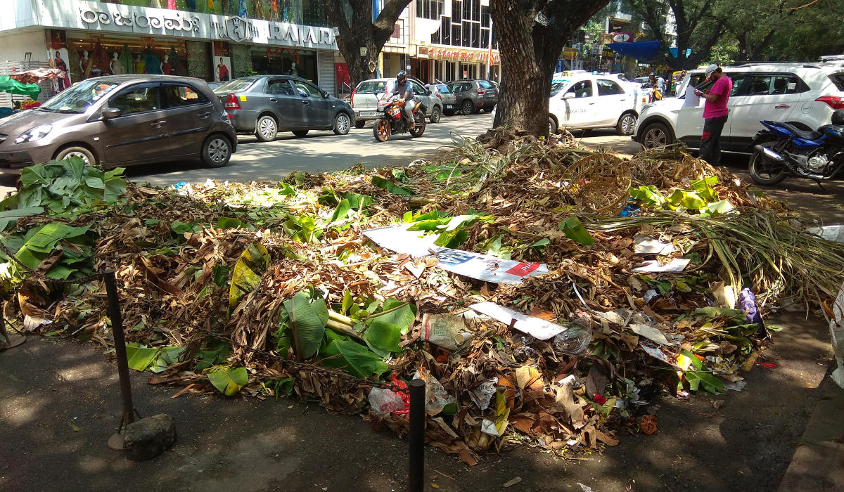 Plantain leaves and waste from the Ganesha festival left uncleared in Gandhi Bazaar on Friday. (DH Photo/Srikanta Sharma R)