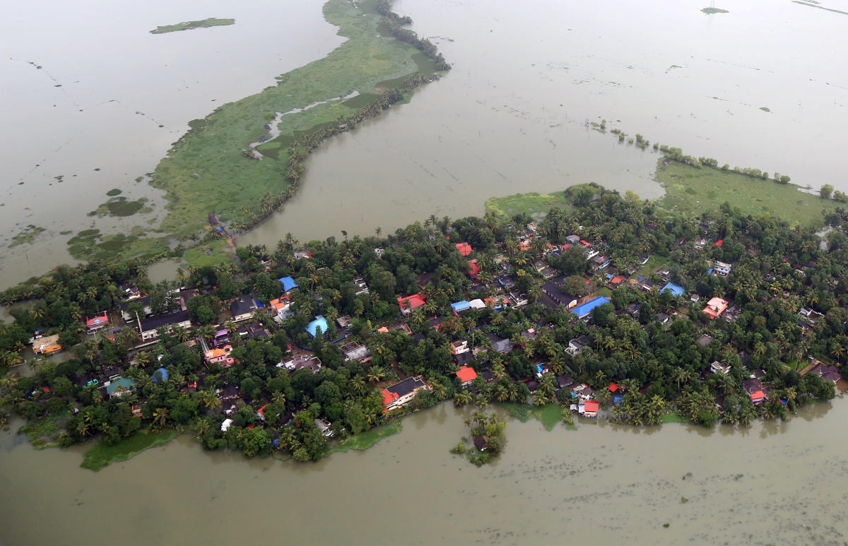 An aerial view shows partially submerged houses at a flooded area in Kerala. REUTERS