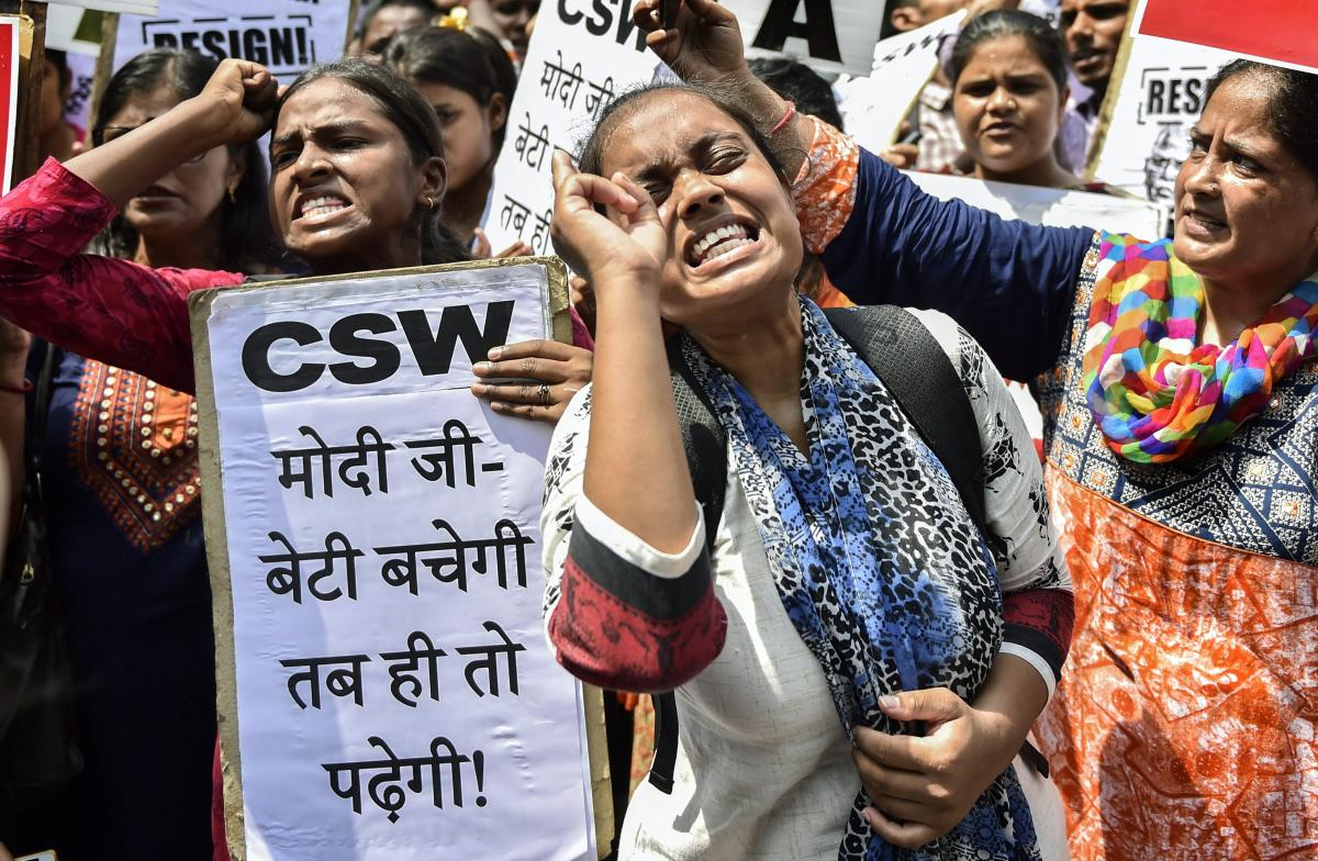 Protestors raise slogans during a protest against the alleged gang rape of a 19-year-old CBSE topper in Rewari, outside Haryana Bhawan in New Delhi. PTI Photo