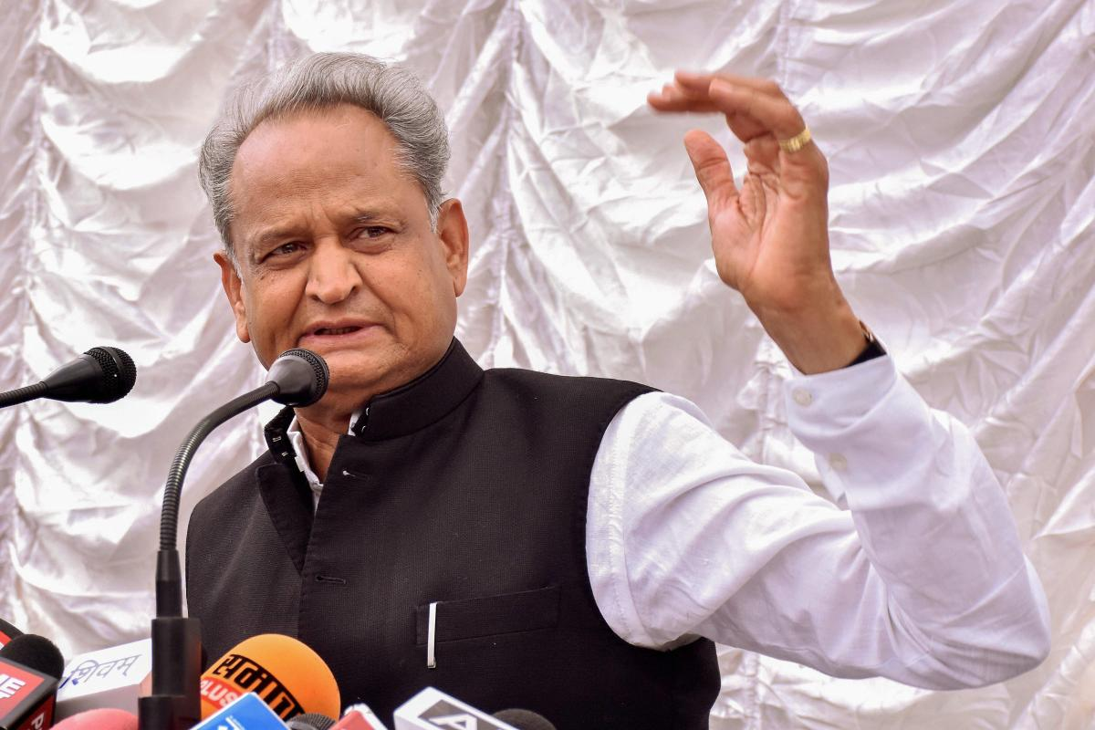 Congress general secretary and former chief minister of Rajasthan Ashok Gehlot addresses a press conference at his residence, in Jaipur, on Monday. PTI