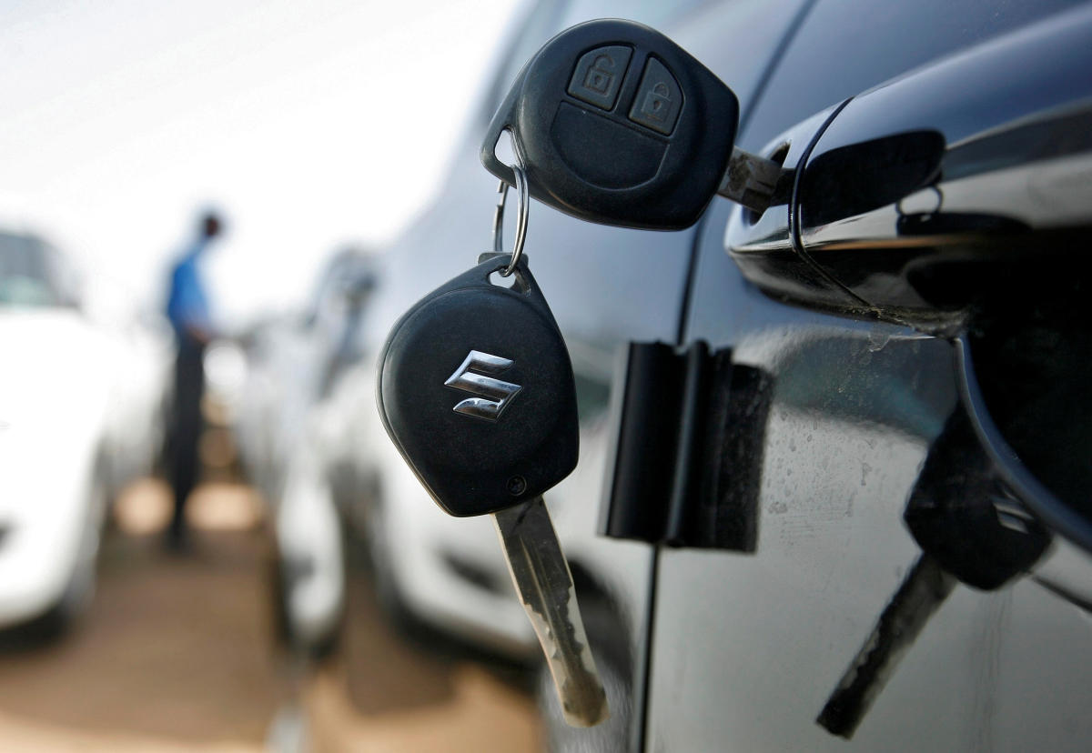 FILE PHOTO: Keys hang from the door of a Maruti Suzuki Swift car at its stockyard on the outskirts of Ahmedabad. Reuters