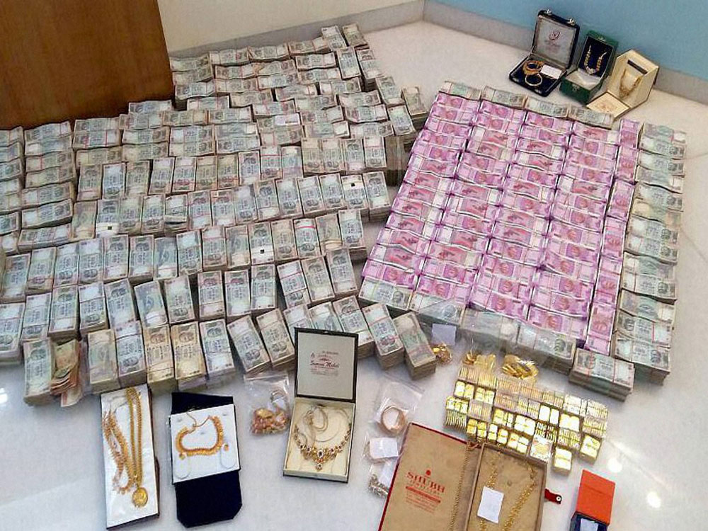 The Income Tax Department (ITD) has seized Rs 14.48 crore in cash during raids at multiple locations, including in poll-bound Karnataka, in the wake of recent cash crunch in the country