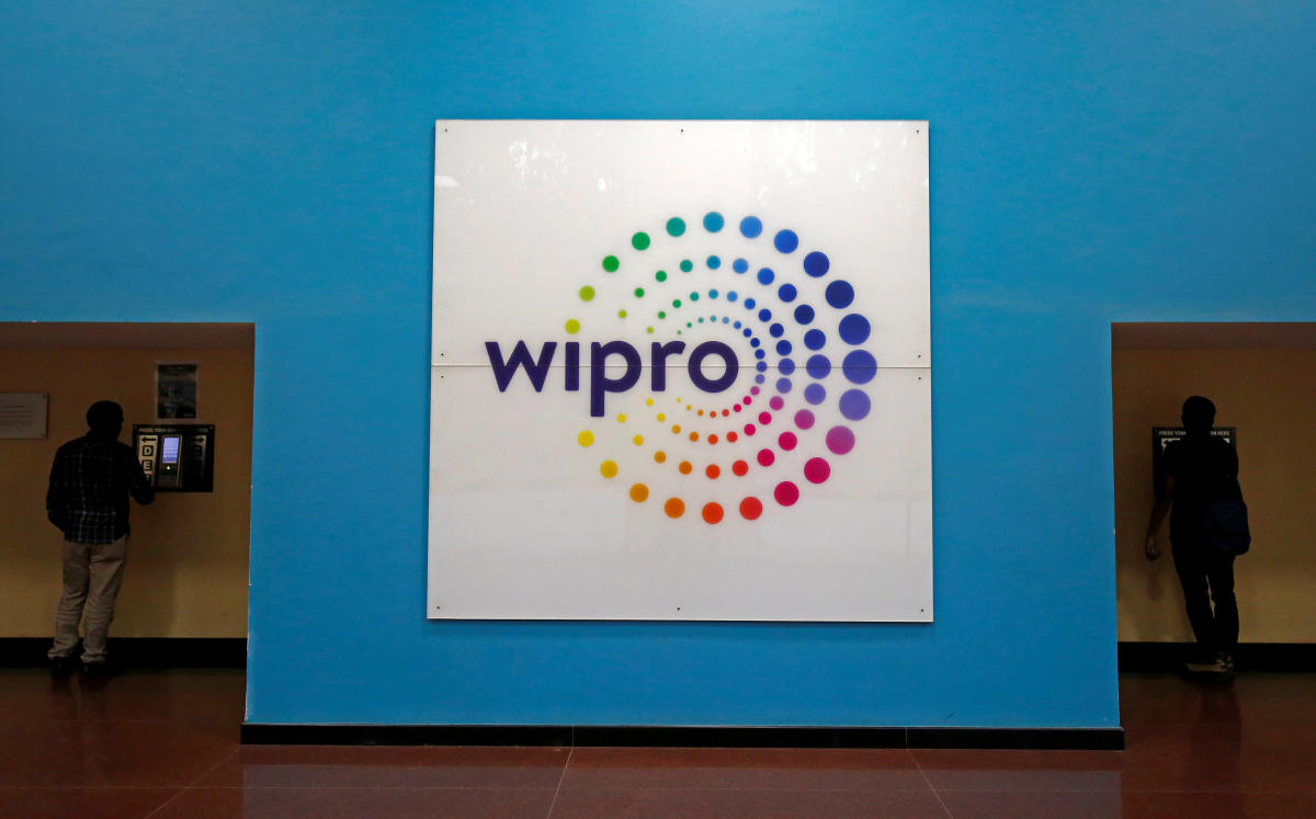 The logo of Wipro is seen inside the company's headquarters in Bengaluru. REUTERS