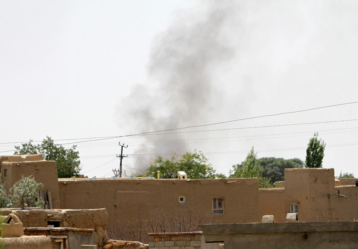 Smoke rises from a residential area where gun battle is going on between Taliban and Afghan forces in Ghazni province, Afghanistan August 10, 2018. REUTERS/Stringer NO RESALES. NO ARCHIVES.