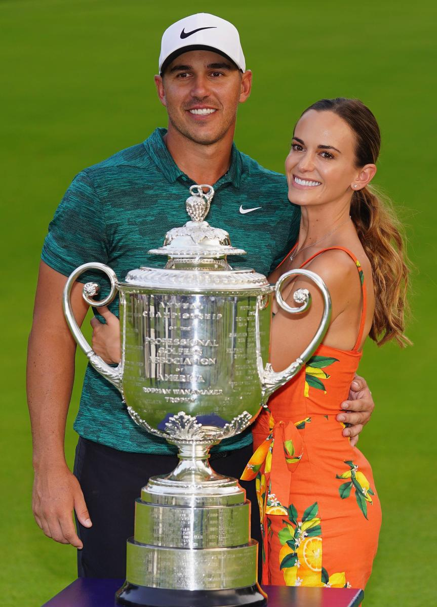 ON CLOUD NINE Brooks Koepka of the US poses with his girlfriend, Jena Sims, and the Wanamaker Trophy after winning the PGA Championship on Sunday. AFP