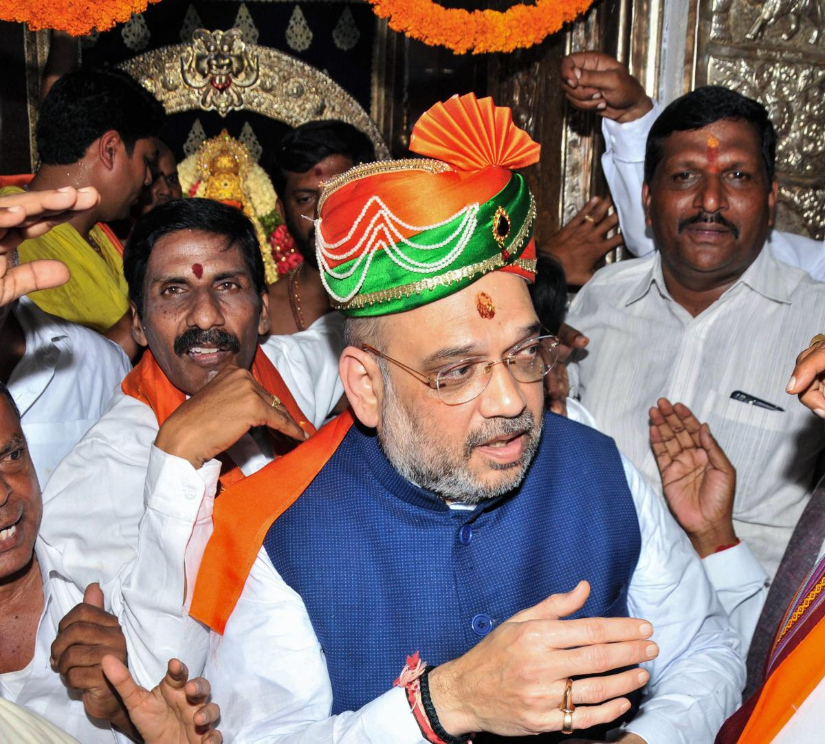 BJP National president Amit Shah arrives to offer prayers at Lal Darwaja Temple, in Hyderabad on Saturday. PTI