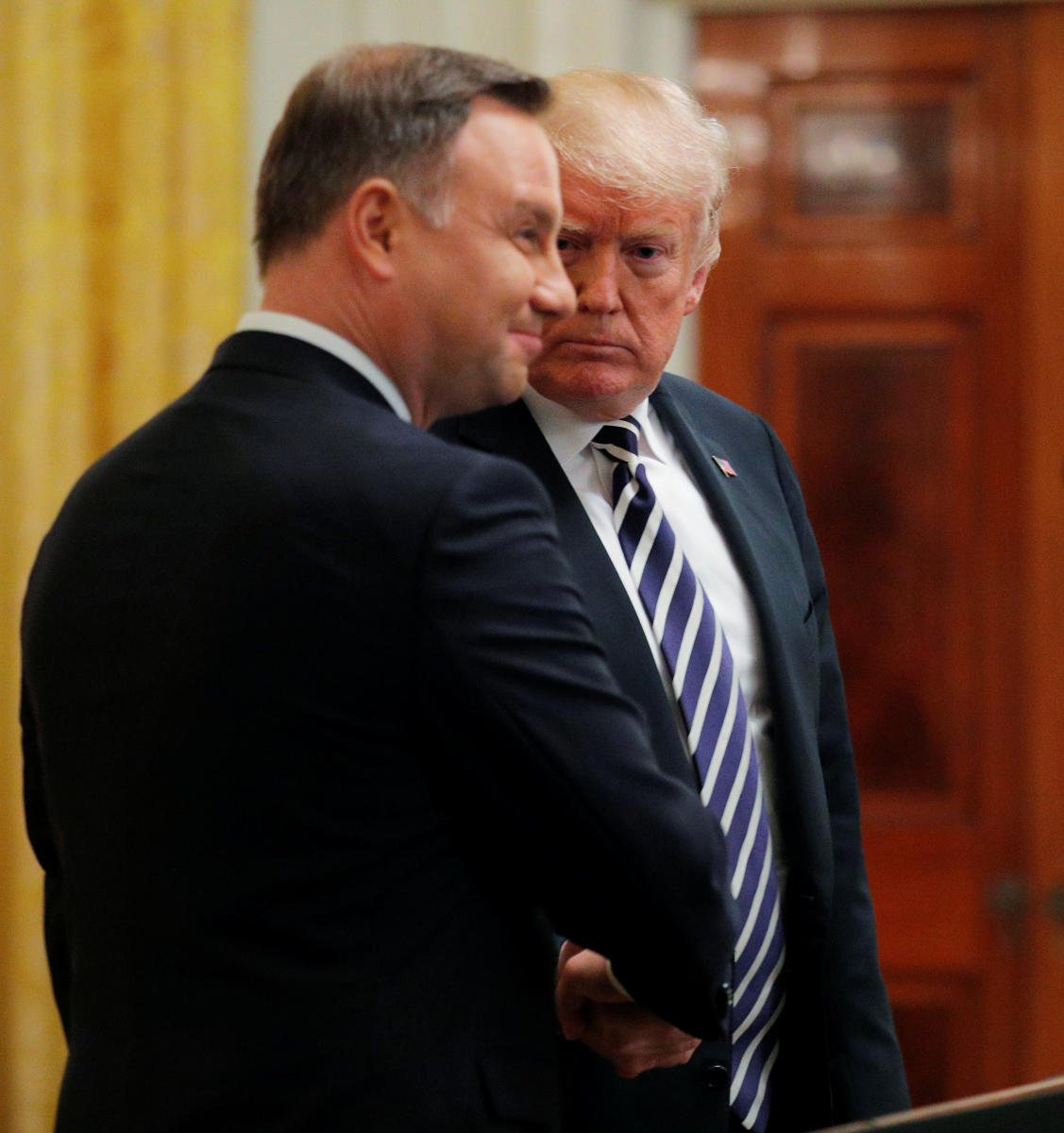 US President Donald Trump with Poland's President Andrzej Duda at the end of a joint news conference in the East Room of the White House in Washington on September 18, 2018. Reuters