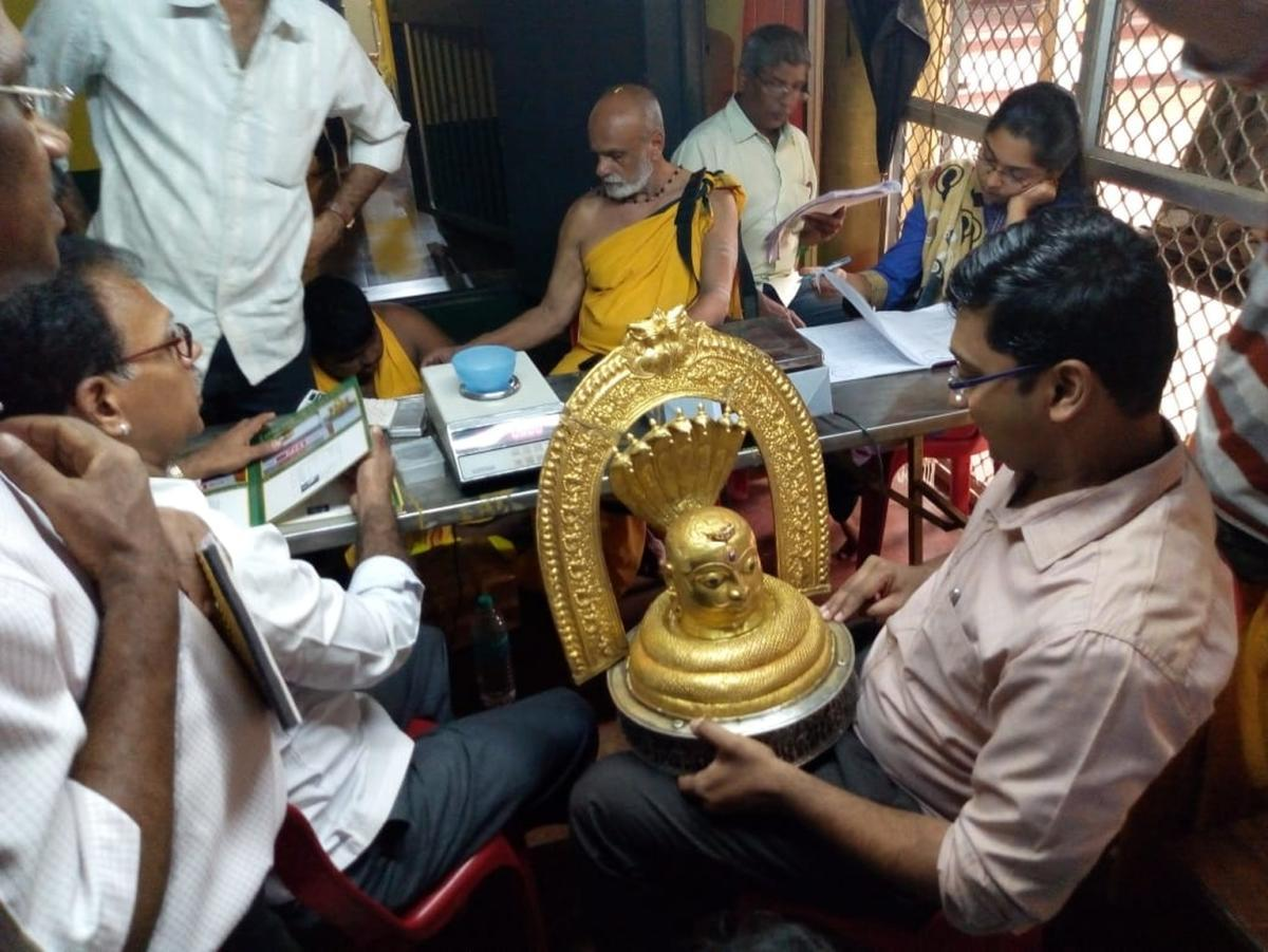Deputy Commissioner S S Nakul inspects a jewellery after taking over administration of the Gokarna temple on Wednesday. dh photo