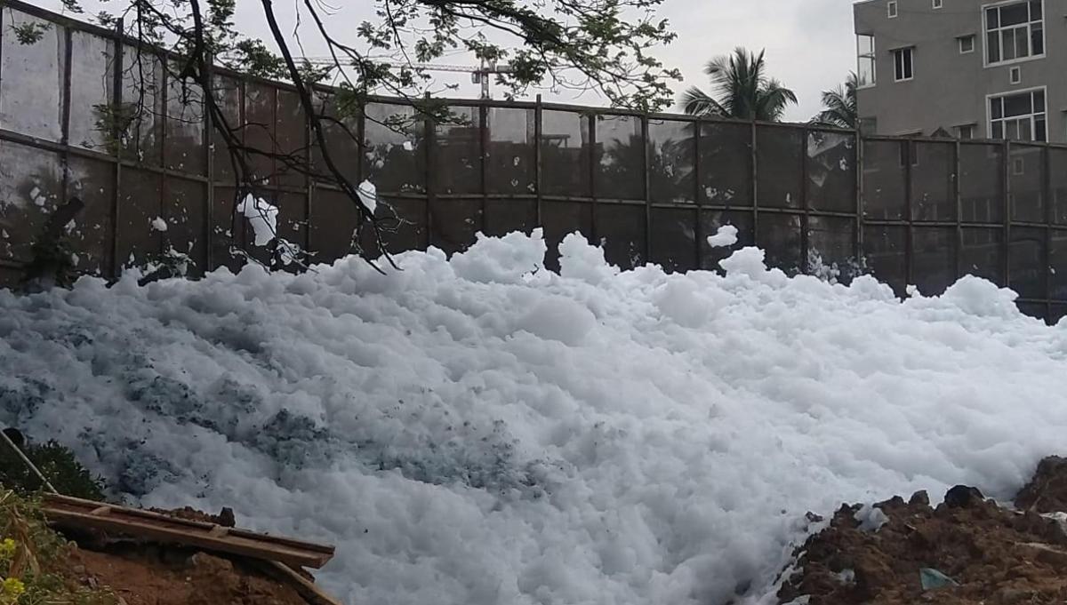 Accumulated foam at the Bellandur Lake weir on Wednesday. DH photo