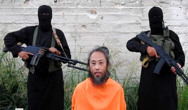 A jihadist group has released videos of a Japanese journalist and an Italian man held captive in Syria in which they appeal for their release, US-based monitors said on Wednesday. picture courtesy Twitter
