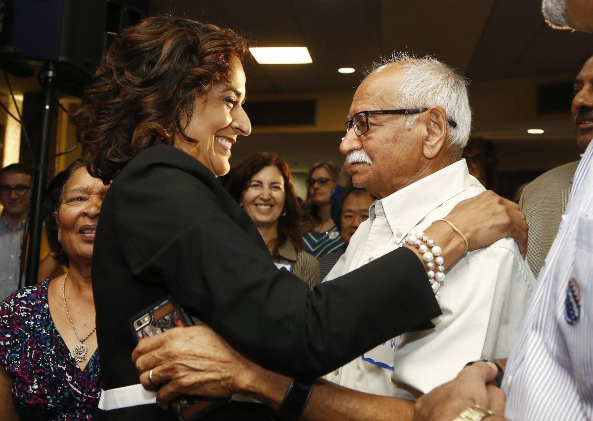 Democratic candidate for the 8th Congressional District, Dr. Hiral Tipirneni, left, hugs her father, Kishor Vyas, as she joins supporters after polls closed in her run against Republican Debbie Lesko as each candidate looks to fill the seat vacated by Rep