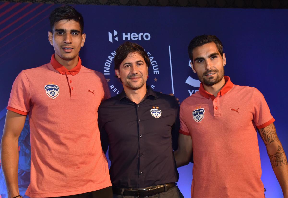Bengaluru FC goalkeeper Gurpreet Singh Sandhu, coach Carles Cuadrat and striker Dimas Delgado at the launch of 5th edition of the Indian Super League in Bengaluru on Thursday. DH photo/ Janardhan B K.