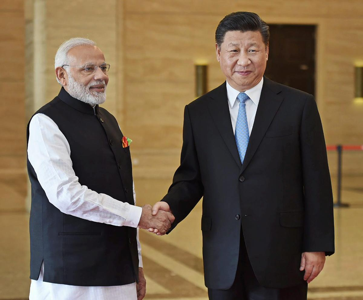 Prime Minister Narendra Modi shakes hands with Chinese President Xi Jinping during their meeting, in Wuhan, China on Friday. PTI Photo