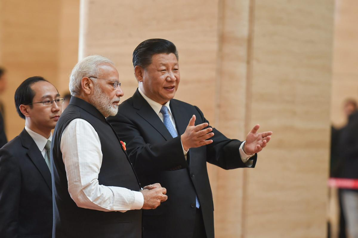 Prime Minister Narendra Modi with Chinese President Xi Jinping during his visit to Hubei Provincial Museum in Wuhan, China on Friday. PTI Photo