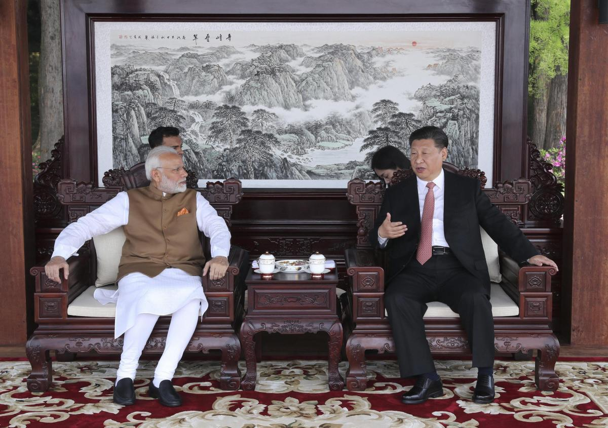 Indian Prime Minister Narendra Modi left, and Chinese President Xi Jinping talk during a meeting in Wuhan in central China's Hubei Province, Saturday, April 28, 2018. AP/PTI Photo