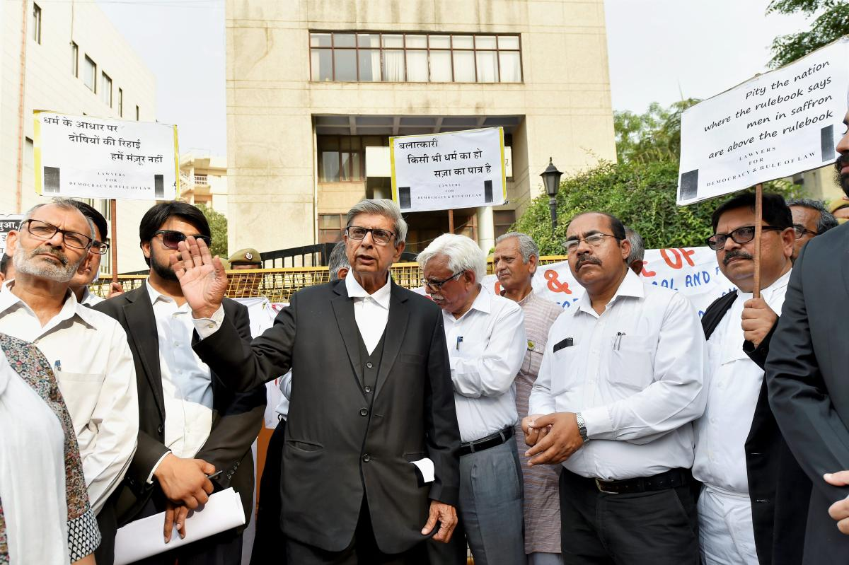 Lawyers display placards during a silent march to Bar Council of India to present a memorandum demanding action against the guilty lawyers of Jammu who came out in support of the culprits in the Kathua case, in New Delhi. (PTI File Photo)