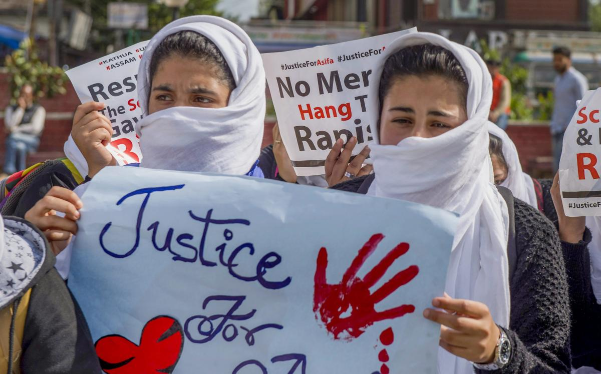 Students hold placards at a peaceful sit-in protest demanding justice for Kathua rape case victim, in Srinagar on Tuesday. (PTI file photo for representation)