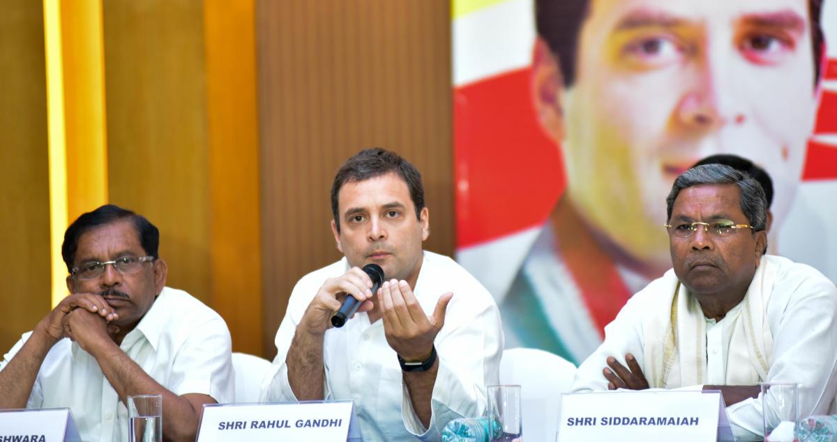 AICC President Rahul Gandhi talking in special press conference, at Lalit Ashok Bengaluru on 10th May 2018. KPCC President G Parameshwara and Chief Minister Siddaramaiah are also seen. Photo/ B H Shivakumar