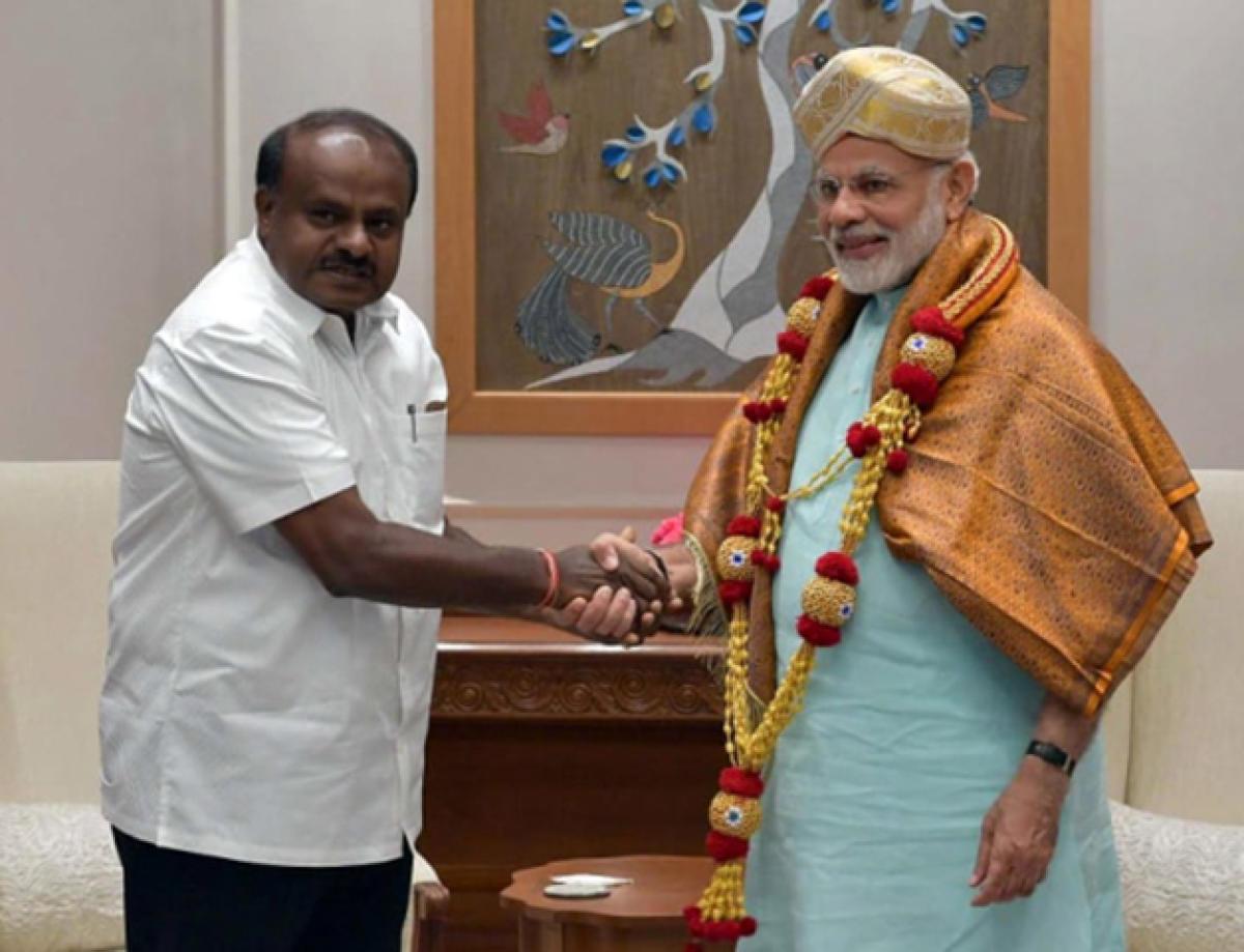 Chief Minister H D Kumaraswamy meets Prime Minister Narendra Modi, during his visit to Delhi, on Monday.