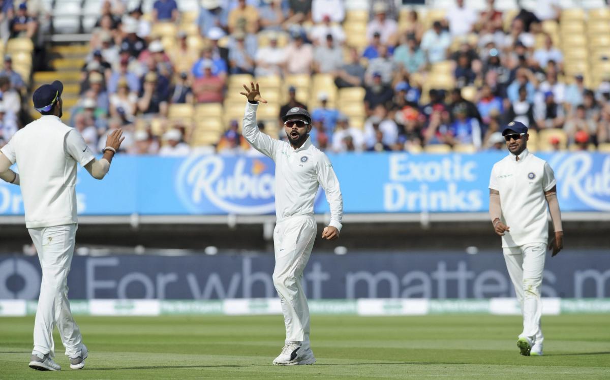 Indian captain Virat Kohli mimics the mic-drop celebration after dismissing his English counterpart Joe Root with a direct hit. AP/PTI
