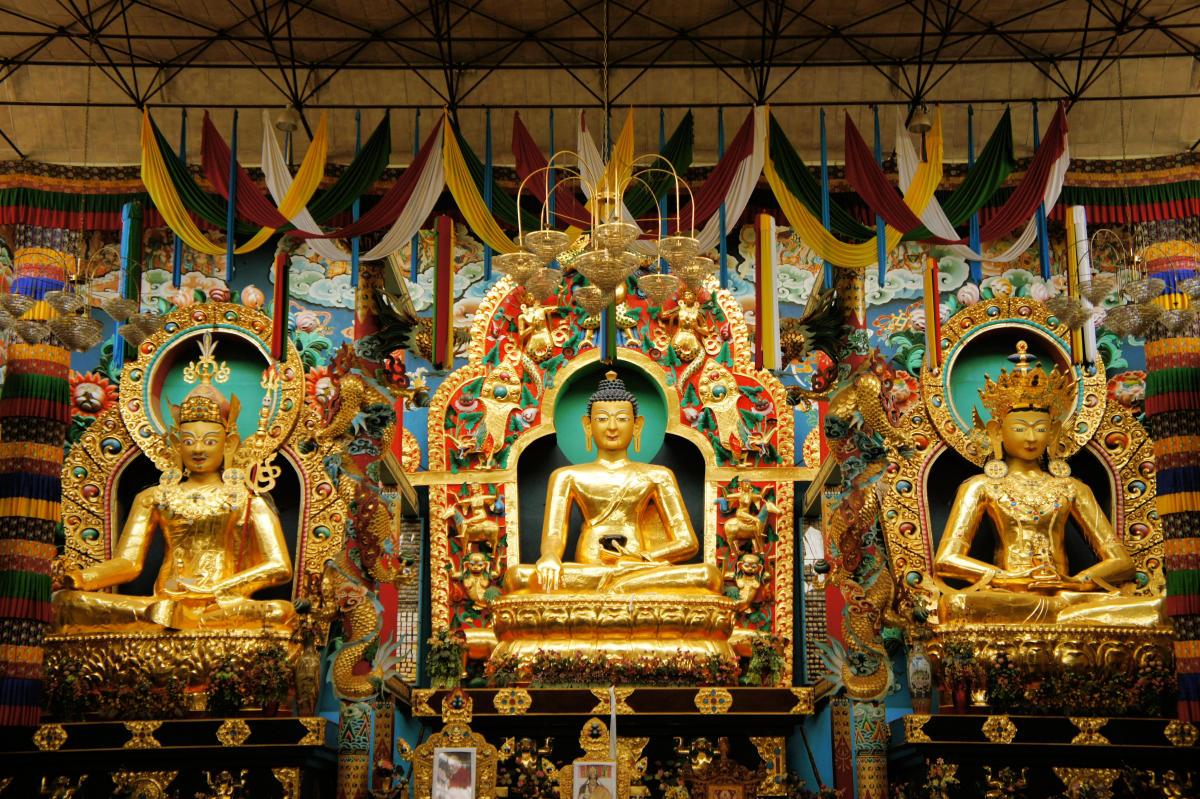 Statues of Guru Rinpoche, Lord Buddha and Buddha Amitayus in Namdroling Monastery, Bylakuppe