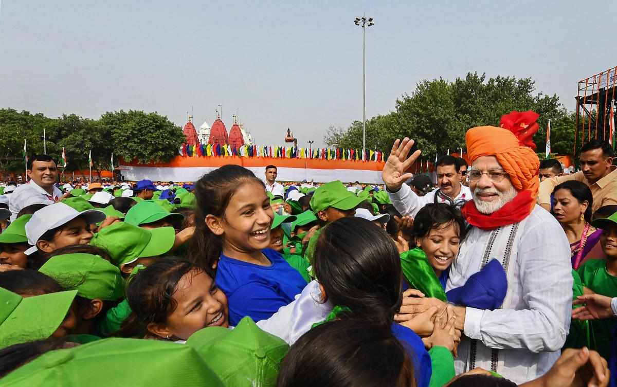 Prime Minister Narendra Modi interacts with children during Independence Day celebrations at the Red Fort, in New Delhi on Wednesday. PTI