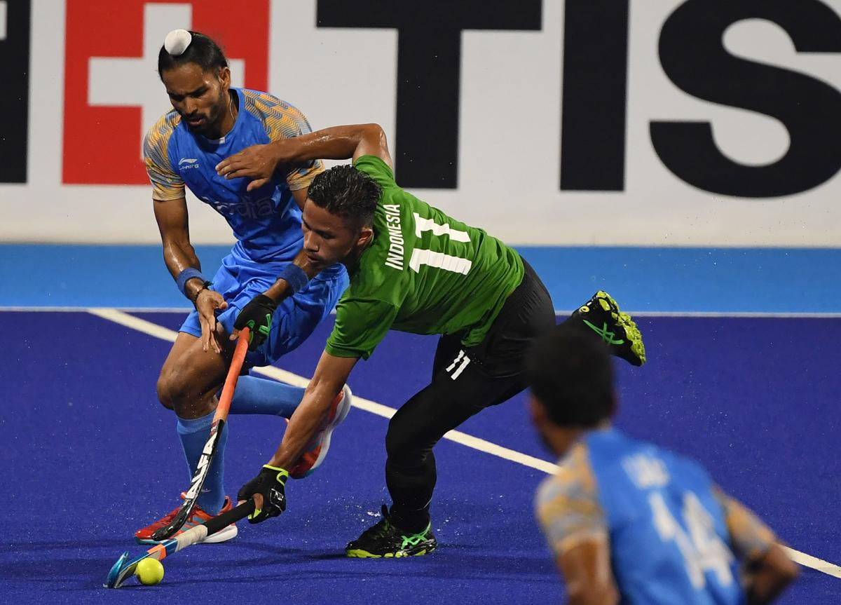SWIFT India's Akashdeep Singh (left) and Indonesia's Ardam vie for the ball during their men's Pool 'A' match. AFP