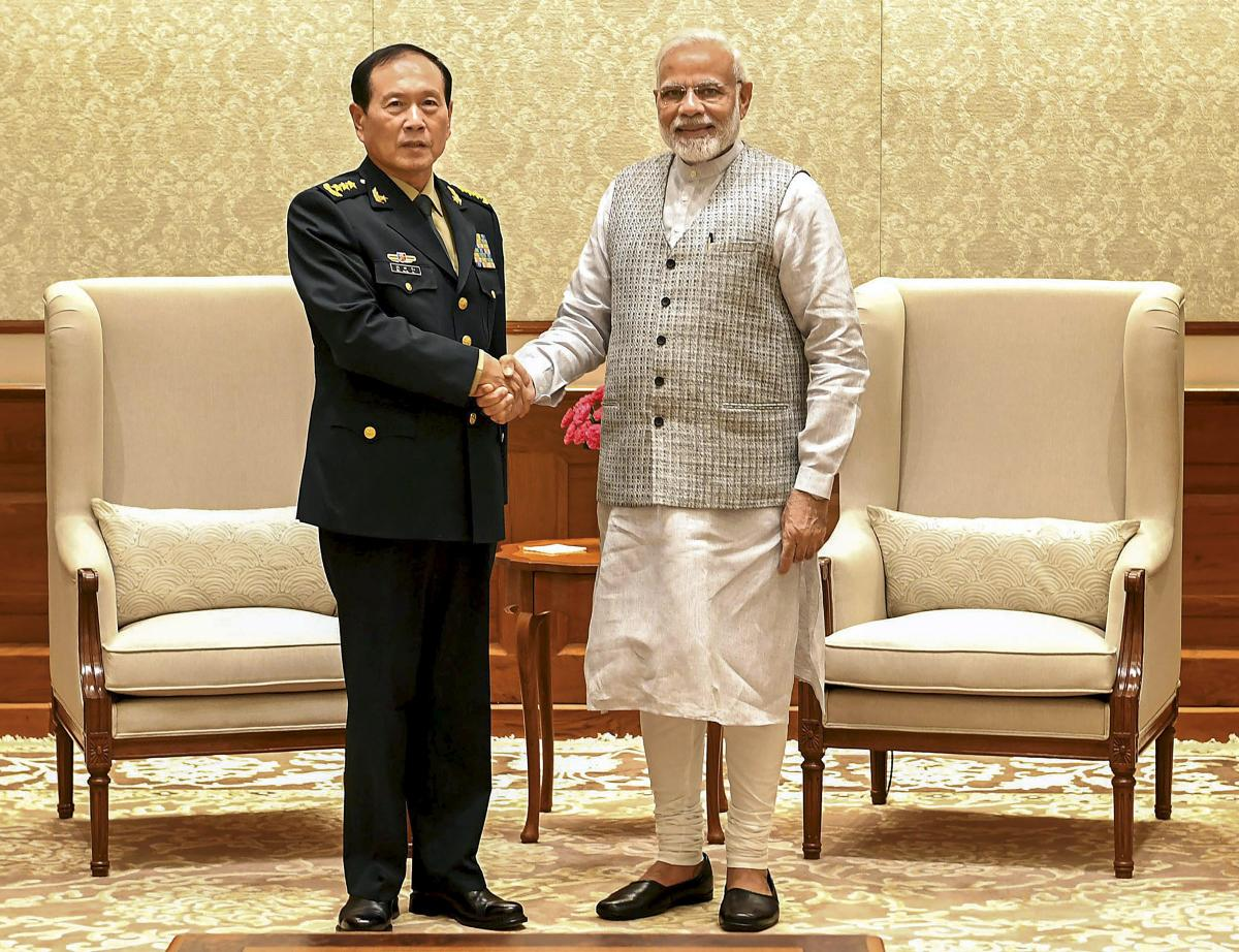Prime Minister Narendra Modi shakes hands with Defence Minister of China, General Wei Fenghe during a meeting in New Delhi on Tuesday. PTI Photo