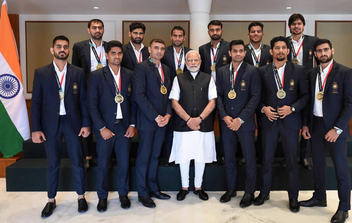 Indian men's Kabaddi team that finished third in the Jakarta Asian Games pose for a photograph with Prime Minister Narendra Modi in New Delhi on Wednesday. PTI